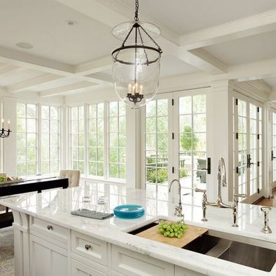 White kitchen with lots of windows. 10 Light french doors ...