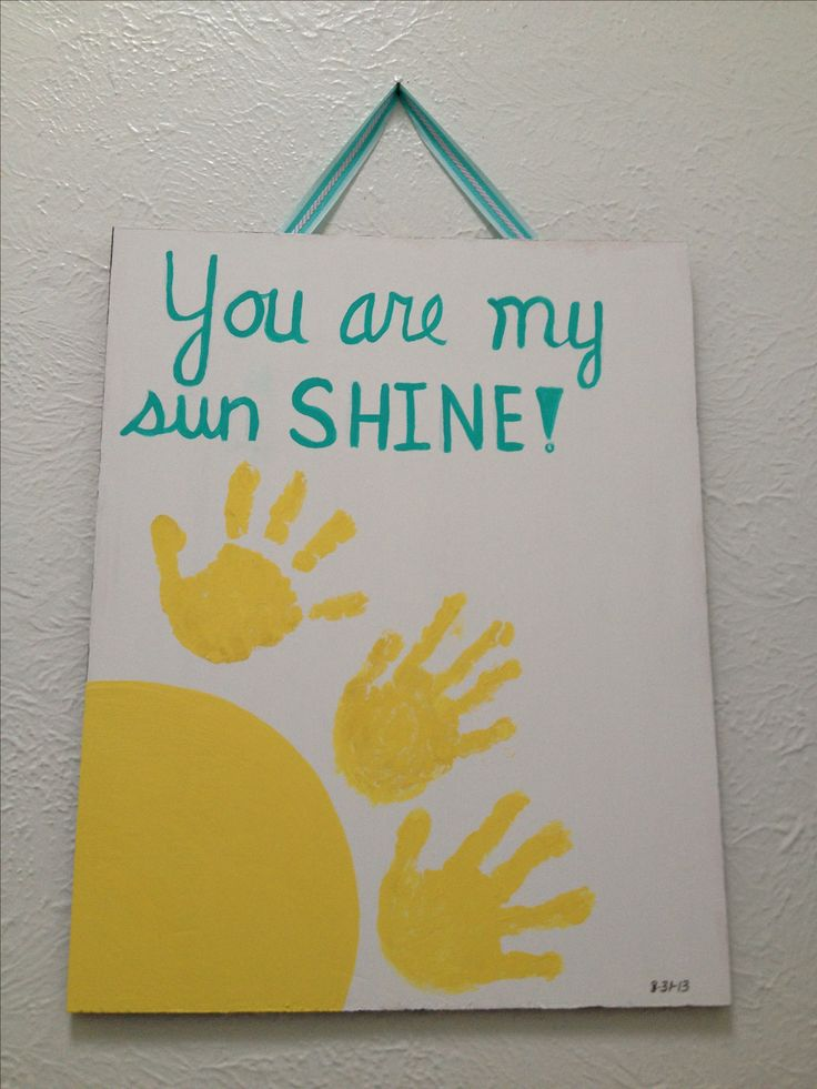 make it into a sunflower diy you are my sunshine artwork with children hand prints too easy and had fun with the kids making it