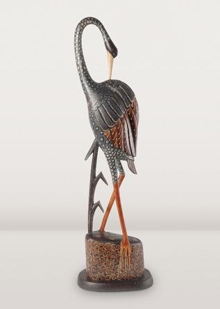 Herons are stunning in real life and this batik sculpture carved from lightweight albesia wood is no different! Elegant and long-legged, it's the perfect piece to fill an empty spot on your coffee table or shelf.