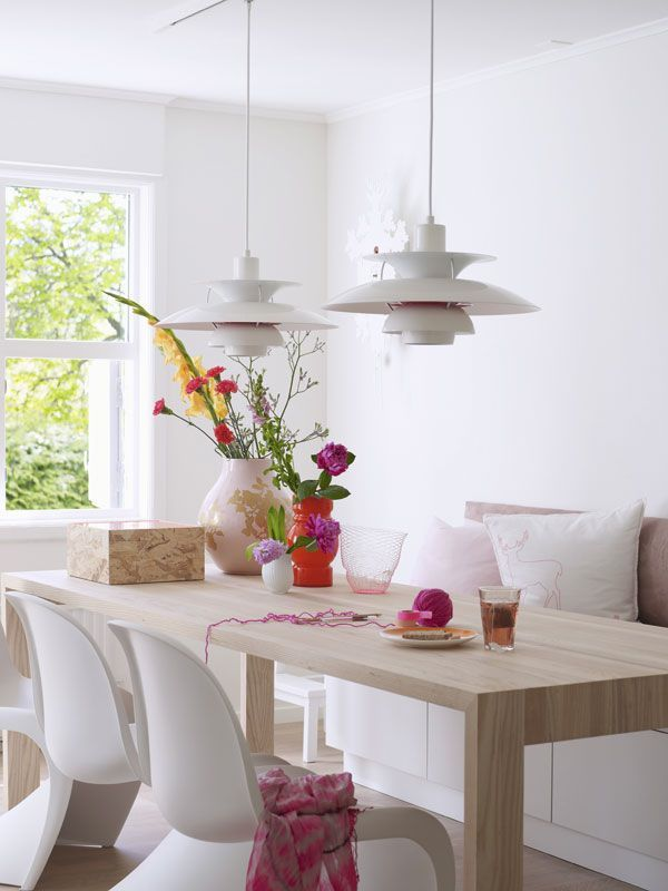 dining room: wooden parsons table with white panton chairs
