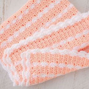 """Peaches & Cream"" Crochet Baby Blanket Pattern Here's a tutorial to make this adorably snuggly soft crochet baby blanket. It's a beautiful pattern that features pretty stripes and finished with a scallop edged trim. Materials Medium Weight Yarn in two colors: Creamsicle and White; and Crochet Hook Size H. Blanket Body Starting with Peach Yarn, Ch 138. …"