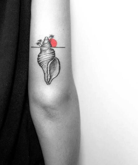 Surrealist sea snail island tattoo on the back of the right arm.
