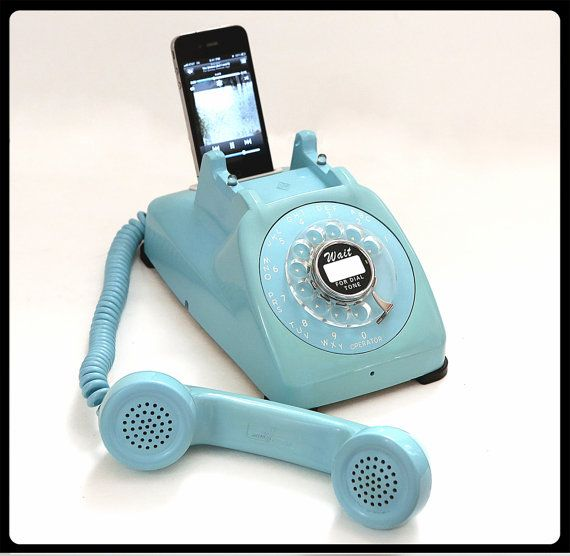 This is so cool. A vintage telephone re-purposed as an ipod dock. Love the color!