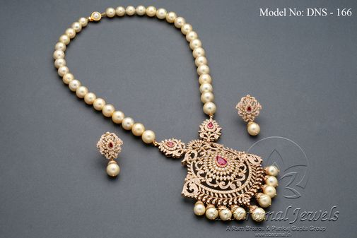 Diamond necklace set studded with diamonds and rubies, and strung with South Sea pearls.