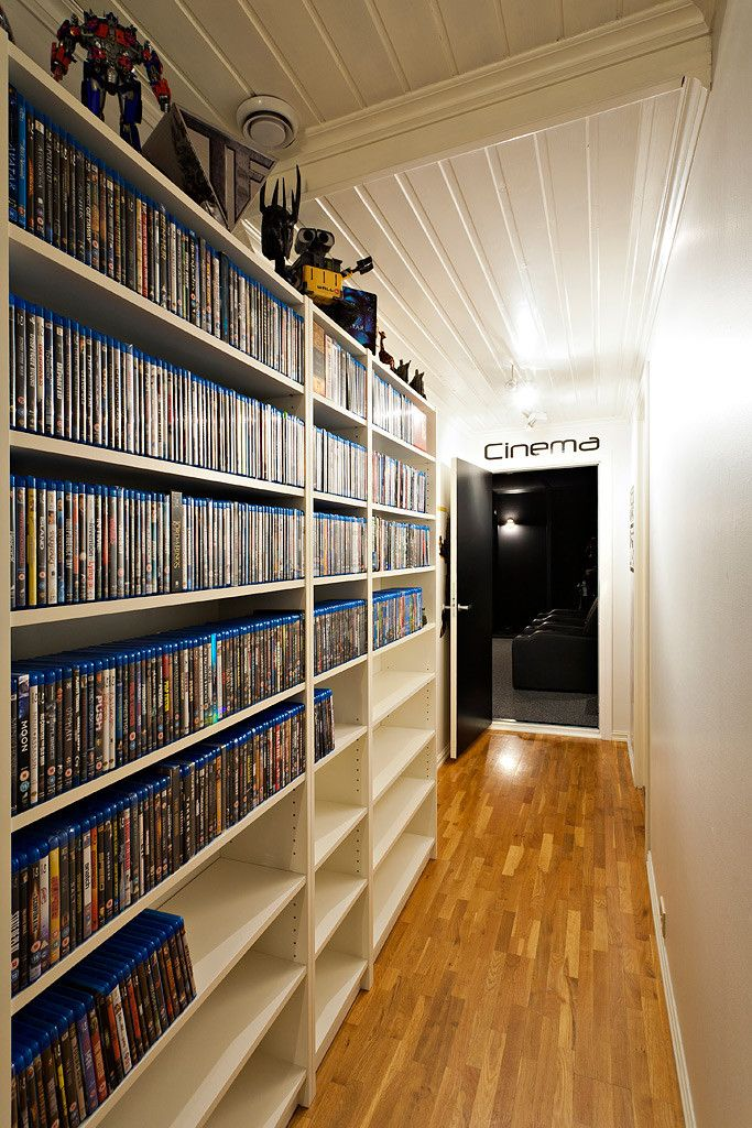Blu-ray shelves...but I'd make it a LIBRARY!!  and right beside a theater room...I wish this is at my house