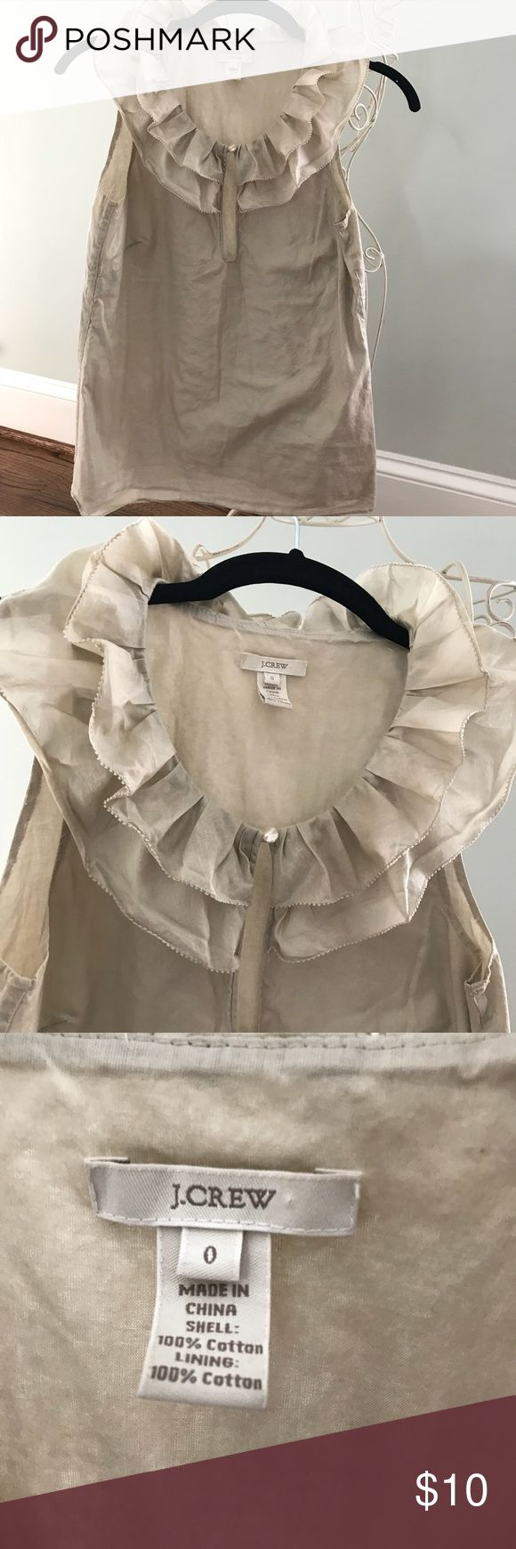 J. Crew Size 0 Double Ruffle Cotton Blouse Love this top! Double ruffle around neckline on front and back. Sleeveless. Beige color with a platinum golden shimmer. 100% Cotton for shell and lining. Keyhole at front with mother-of-pearl looking button. J. Crew Tops Blouses