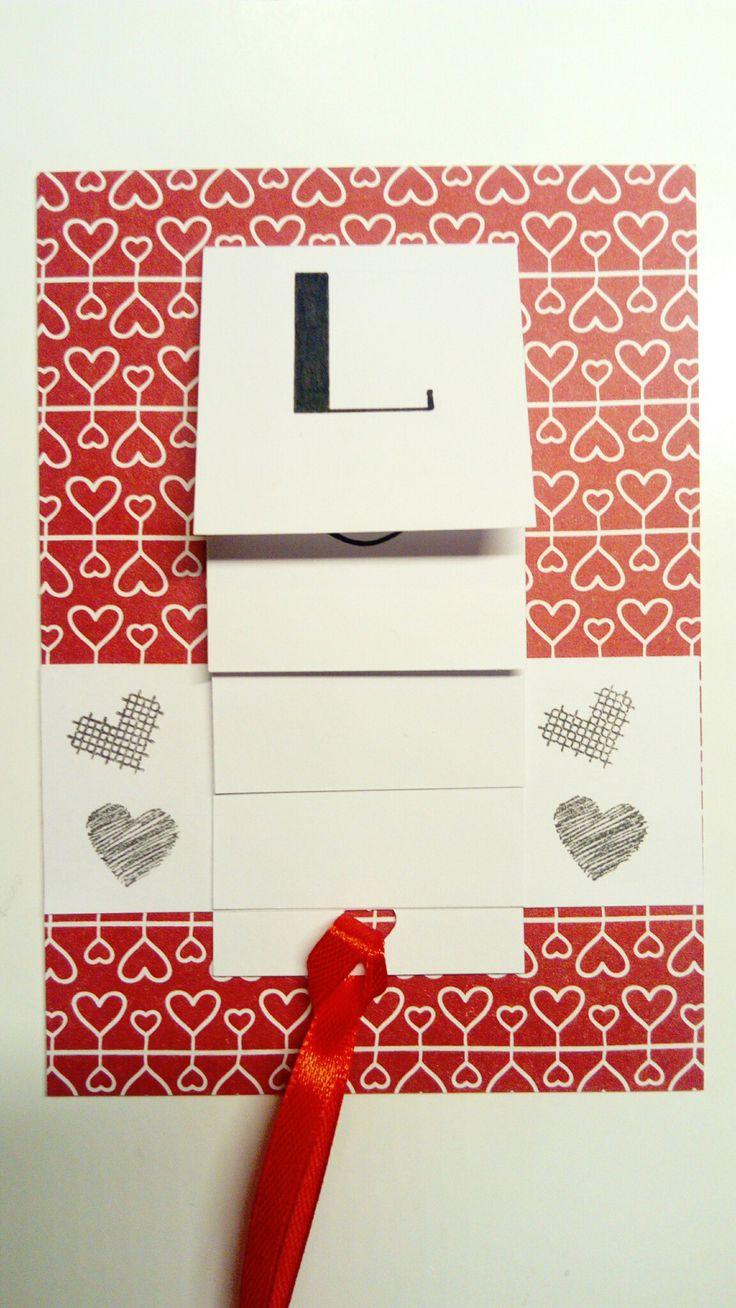 Waterval valentijnskaart met tekst LOVE gemaakt met design papier (Action) en hartjes stempels (Marianne Design).
