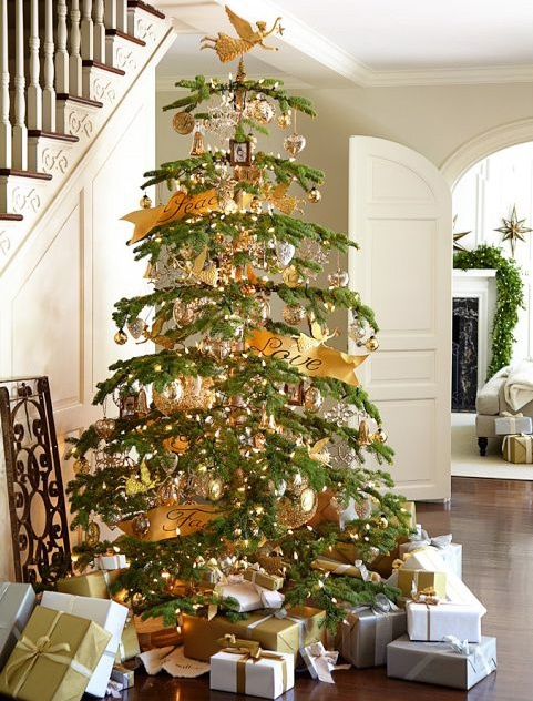 Elegant and simple, carried through to the uncluttered palette of white, gold and silver for the gift wrap. I'm not even sure that it needed the distraction of the filigree gate sitting on the floor behind the tree. John's favorite type of tree.. .