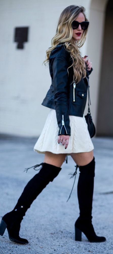 Edgy winter outfit styled with a cable knit sweater dress, leather jacket, and black over the knee boots.