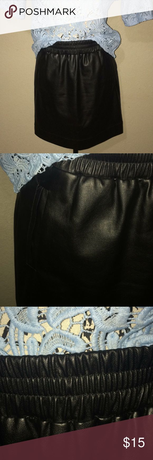"""Loft Faux Leather Mini Skirt Faux leather  Black Zipper back 17 1/2 """" Long 2 side pockets Thick stretchy waist band Lined inside Super cute and sexy! Great condition! LOFT Skirts Mini"""