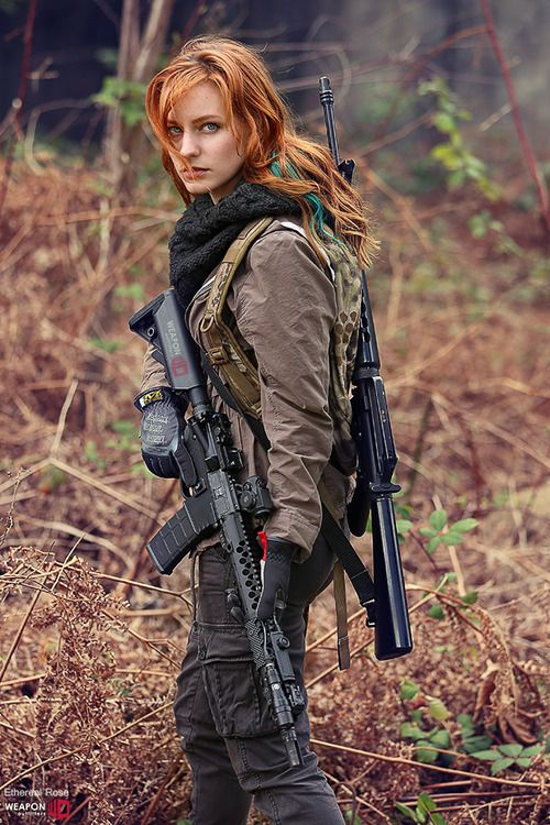 Damn son, where'd you find this? Seriously, this chick is carrying TWO FRICKIN RIFLES! LIKE A BOSS!