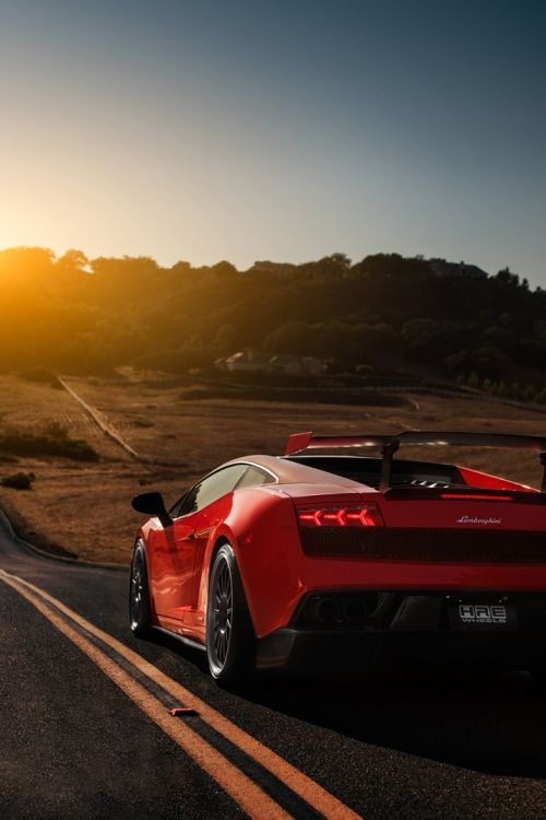 Lamborghini Gallardo driving into the sunset. Click on the pic sign up today to win a chance to drive this badboy!