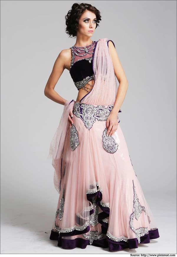 The blush pink netted lehenga with an illusion styled #blouse  #bridallehengas #weddinglehengas