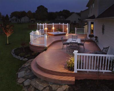 Great spa deck with privacy screen, curved steps and deck lights for safety. #Decks #TimberTech