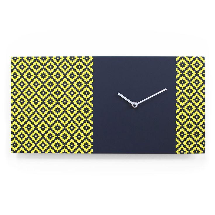 Stylish designer high-end modern horizontal rectangular wall mounted analog clock in grey and yellow.