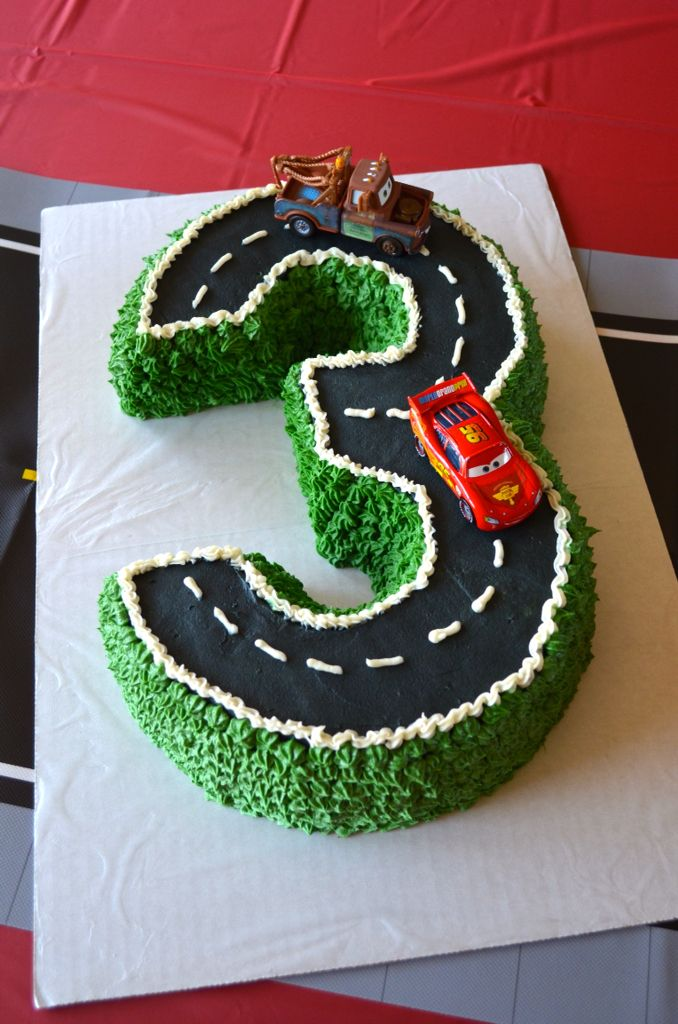 Cake for Disney Pixar Cars/Lightning McQueen third birthday party. Made with two Bundt cakes cut to shape the number 3.