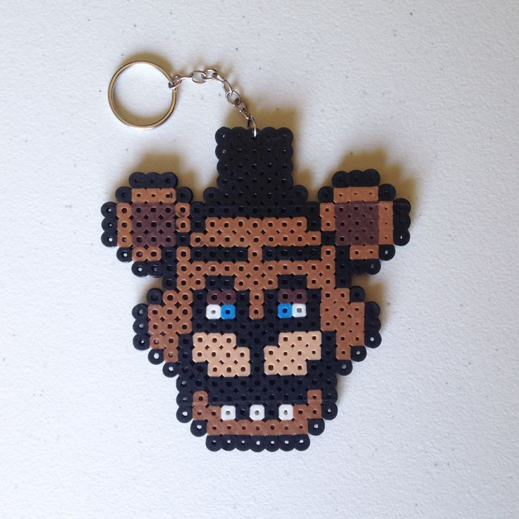 Freddy Fazbear, from the hit video game series Five Nights at Freddy's (FNAF) made from Perler Beads. Inspired by Retr8bit on DeviantArt (http://retr8bit.deviantart.com/art/Five-Nights-At-Freddy-s-Animatronics-Set-1-514146186)