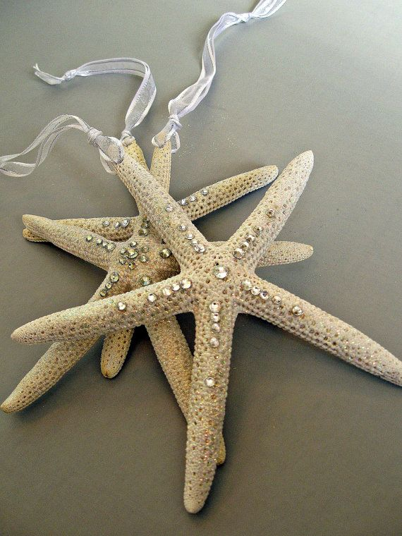 Nautical themed starfish ornament with Swarovski crystals and glitter.