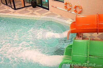 Jets sliding down water slides and indoor pool.