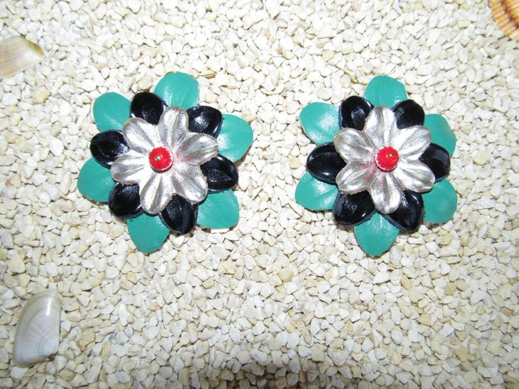 Handmade earrings (1 pair)  Made with leather flowers and glass beads.