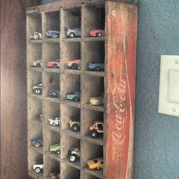 For a rustic touch, an old soda crate can be used to display smaller scale model cars.