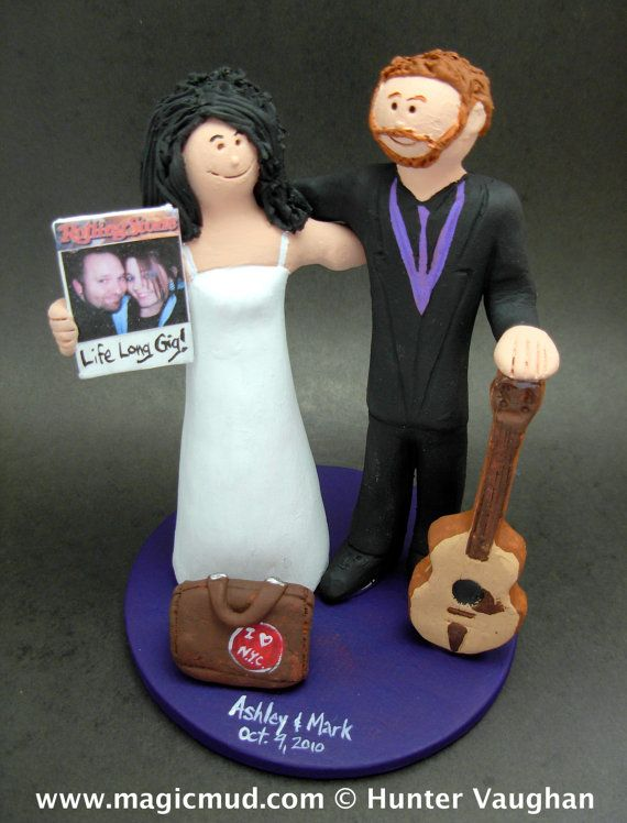 Wedding Cake Topper for a guitar playing groom    Wedding Cake Topper for an Acoustic Guitar Player, custom created for you! Perfect for the marriage of a Guitar Playing Groom and his Bride!    $235   #magicmud   1 800 231 9814   www.magicmud.com