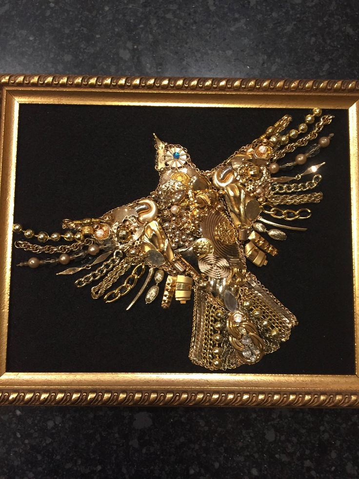 This is a 100 percent handmade recycled jewelry art bird. First I glue black felt on cardboard backing and then I securely glue the jewelry on the fabric. The jewelry ranges from contemporary to vintage. I use trinkets, rhinestones, beads, pearls, and chains, from necklaces,