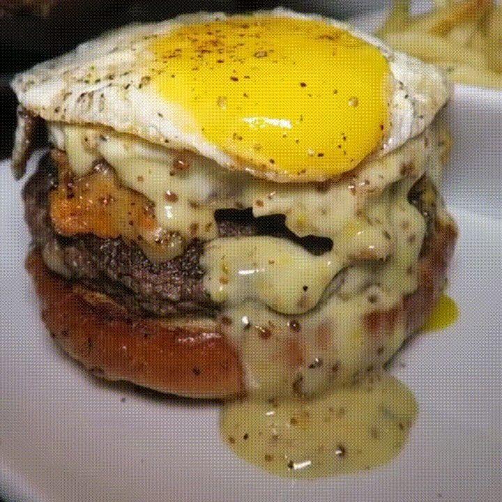 Gourmet burger with jalapeño bacon sweet potato sausage hash havarti cheese mustard maple mayo and a fried egg [720 x 720] [GIF]