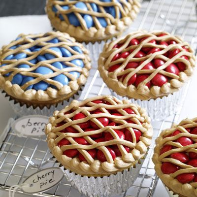 Bake-Sale Pie Cupcakes - The blueberry and cherry filling is blue or red candies, and the frosting is tinted to look like a lattice crust.