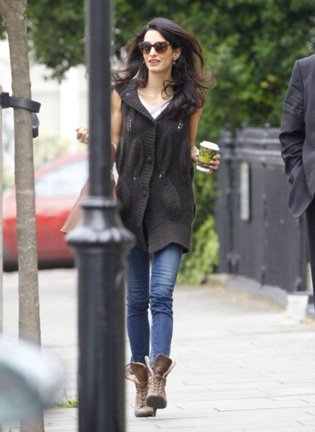 Exclusive... 51741488 British barrister and socialite Amal Alamuddin grabs a coffee to go in London, England on May 15, 2015. Amal is in town to support husband George Clooney in his London premiere of