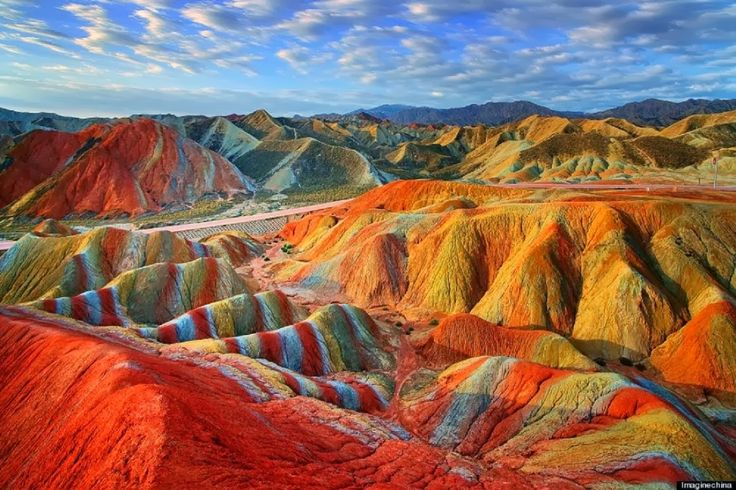 """The Danxia landform (Chinese: 丹霞地貌; pinyin: dānxiá dìmào) refers to various landscapes found in southeast, southwest and northwest China that """"consist of a red bed characterized by steep cliffs"""". It is a unique type of petrographic geomorphology found in China."""