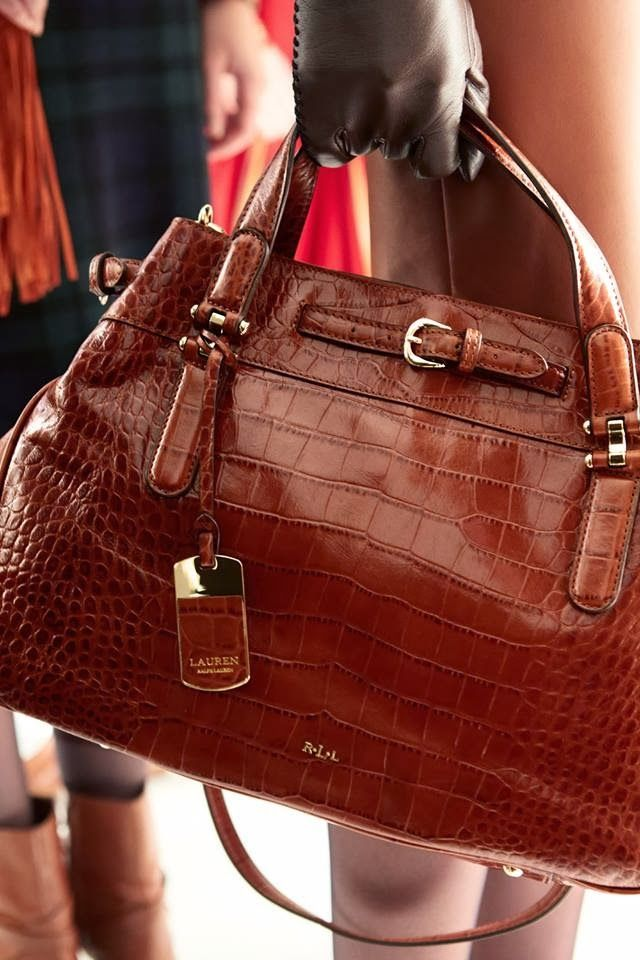 """Ralph Lauren.  Choose a really good designer handbag to carry wherever you go.  It should be a bag that """"floats your boat,"""" that excites you each time you carry it.  It should also go with daytime outfits.  Of course, segue to a nice evening bag if the rendezvous is formal."""