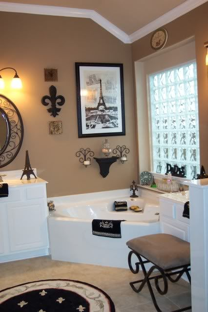 This is my PARIS themed master bathroom. On the color chart, paint your ceiling the shade lighter than your wall. I removed the large mirrors the builder put and spray painted Hobby Lobby mirrors and hung them. I got a lot of my nic-nacs from PARIS, Las V