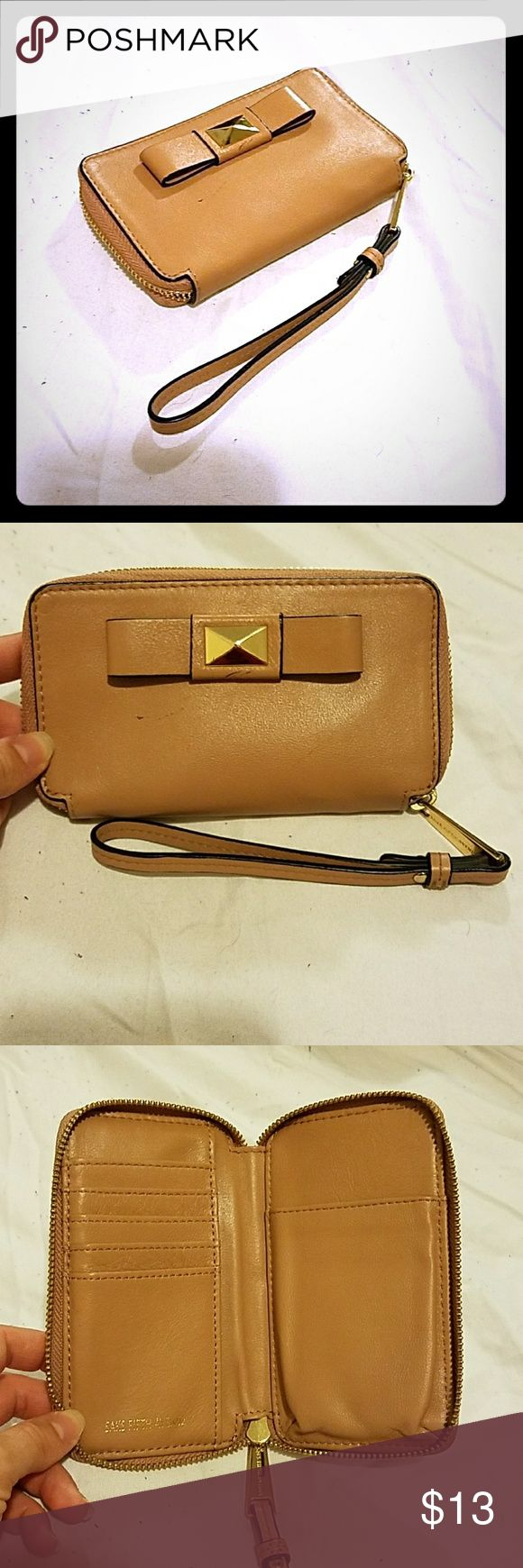 ❤FLASH SALE❤Saks Fifth Avenue Wristlet Beige leather Saks Fifth Avenue Wristlet wallet.  I purchased it from Saks last year. It's in good condition except 2 minor scratches  (see pictures). LIKE THE LOOK? TUNIC and MK JEANS AVAILABLE! CHECK OUT MY OTHER LISTINGS. Saks Fifth Avenue Accessories