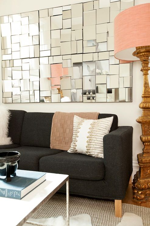 Rue Magazine: Pink and gray living room with collection of CB2 Perspective Mirrors hung above dark ...