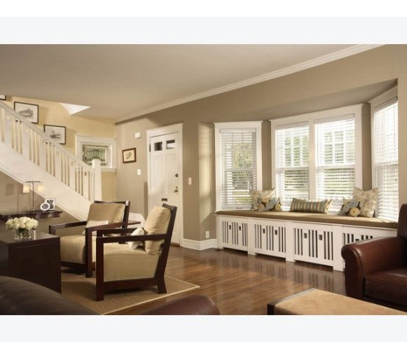 Living room with bay window and radiator covers.