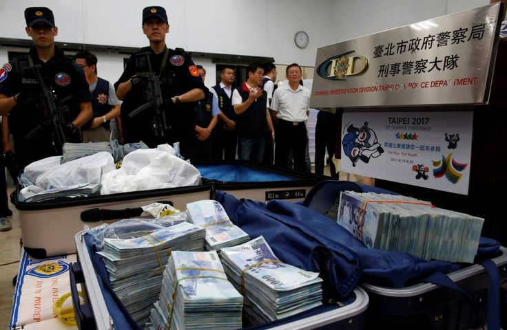 The money recovered in Taipei in July after criminals programmed ATMs to spew cash.