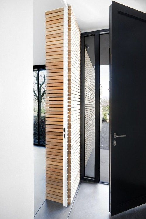 continuous interior/exterior slatted wood wall