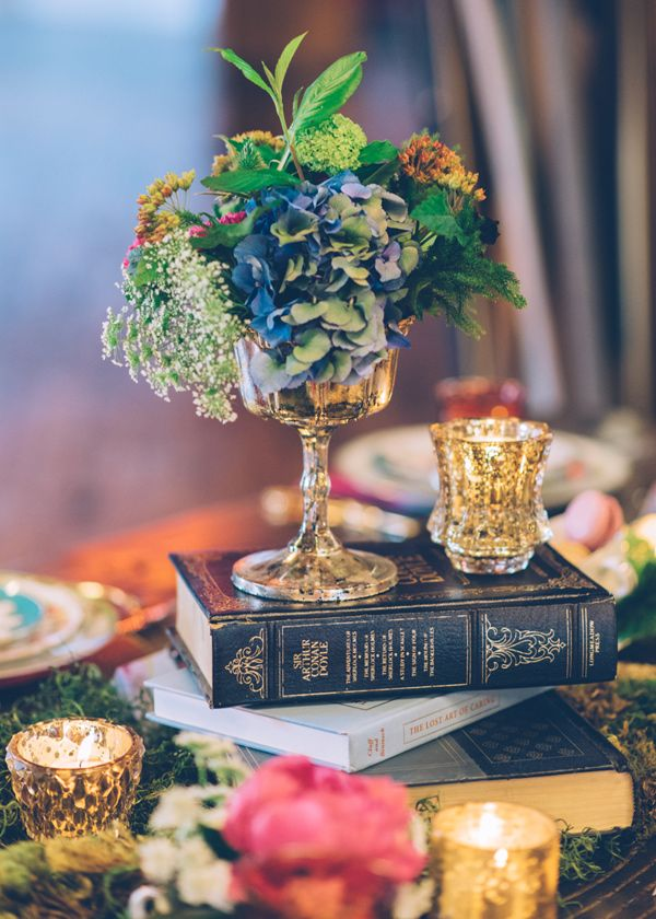 vintage book centerpiece - photo by Ed and Aileen Photography http://ruffledblog.com/whimsical-chicago-wonderland-styled-shoot