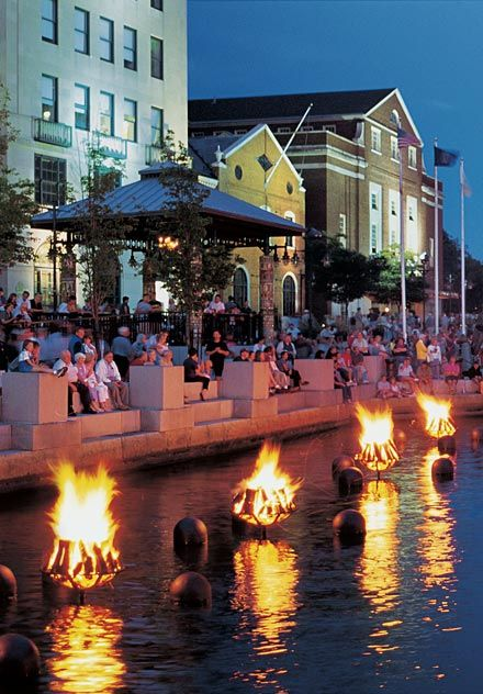 Juxiposition of two continually dynamic elements -- WaterFire in Providence, RI. Photo by Barnaby Evans