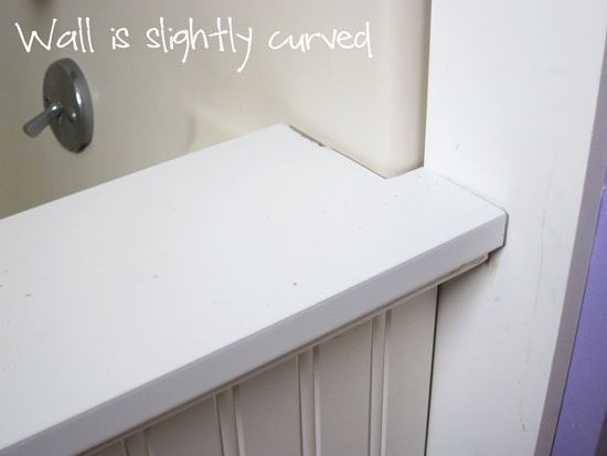 Want to update a bathtub but have no budget to do so? Check this bathroom makeover out where the old tub gets an update with some PVC boards and molding | In My Own Style
