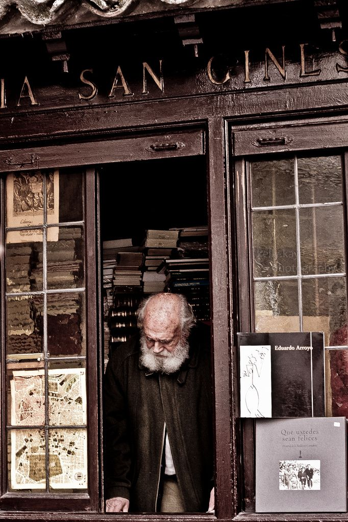 An old man at a bookstore in Madrid, Spain by Kelly Kaye. #Spain #Madrid #Books #Bookstore