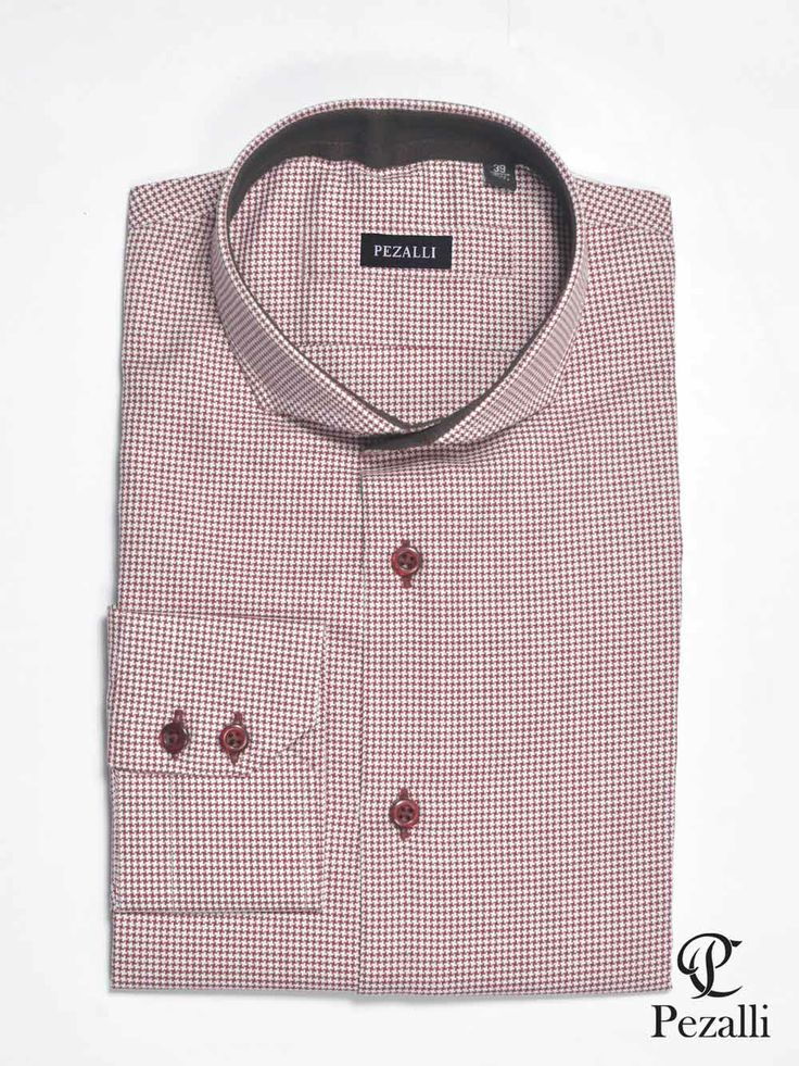 100% Egyptian cotton in hounds tooth design fabric. Contrast trim on inner collar with contrast buttons on shirt. 2 button cuff.