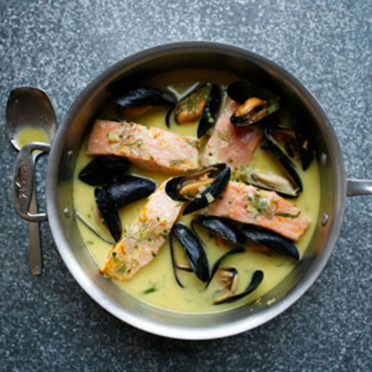 Mussels and Norwegian salmon are poached and served in a subtly rich butter sauce flavored with white wine, vermouth, and bright saffron. Serve this dish with plenty of crusty bread to soak up the broth.