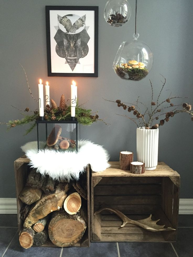 livingonabudgetdk | Bloggers Delight. | Maximum coziness in minimal space. Advent candles, a shaggy sheepskin, gatherings from the forest, firewood and even an antler -- the elements of a Nordic cabin in one little vignette.