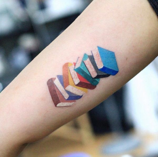 The colorful Stack of Books. Colors on the arm when combined with the books make a great tattoo design to try.