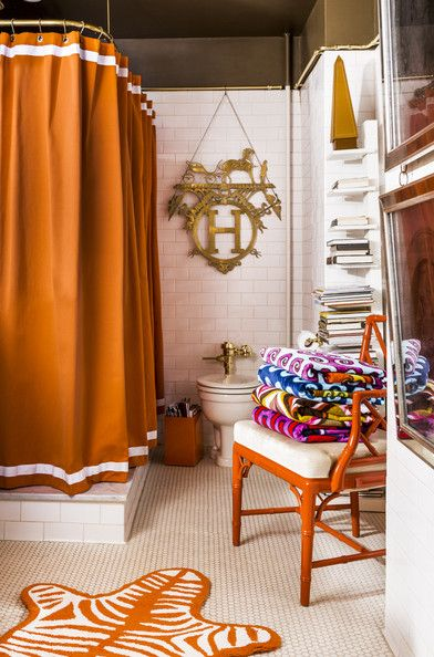Jonathan Adler and Simon Doonan's colorful shower curtain, chair, and an area rug