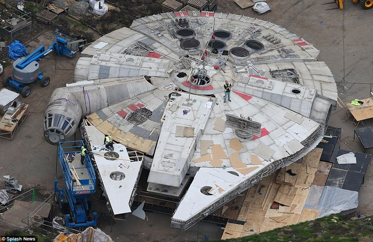 Workers are shown building the Millennium Falcon's outer shell in preparation for filming ...
