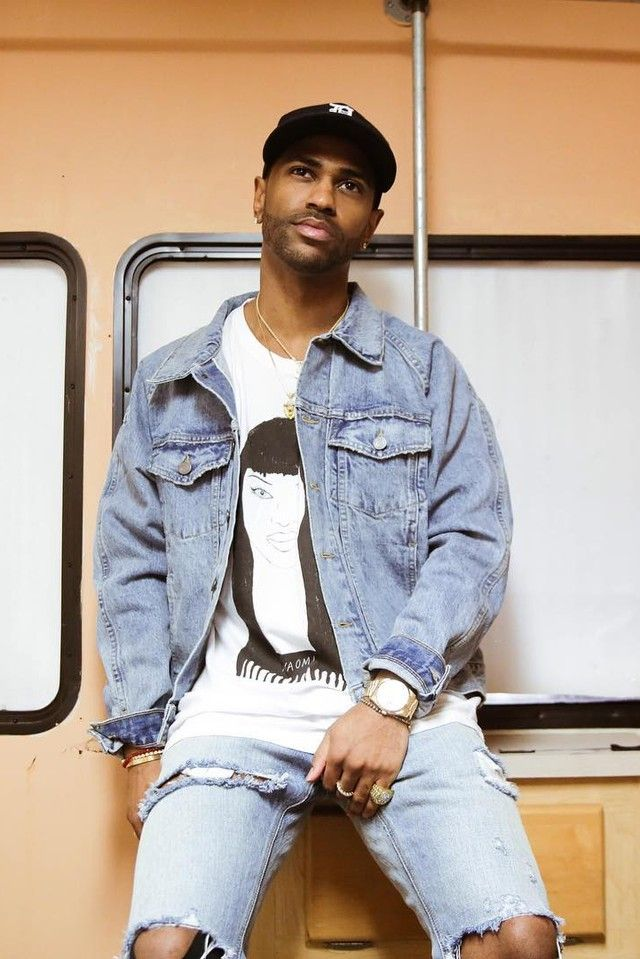 Big Sean wearing  Fear of God 4th Collection Denim Raglan Trucker Jacket, Fear of God 4th Collection Selvedge Denim Vintage Indigo Jean, Deerdana Naomi Campbell Exclusive Tee, Adidas Men's Superstar Shoes, New Era Detroit Tigers Home Cap