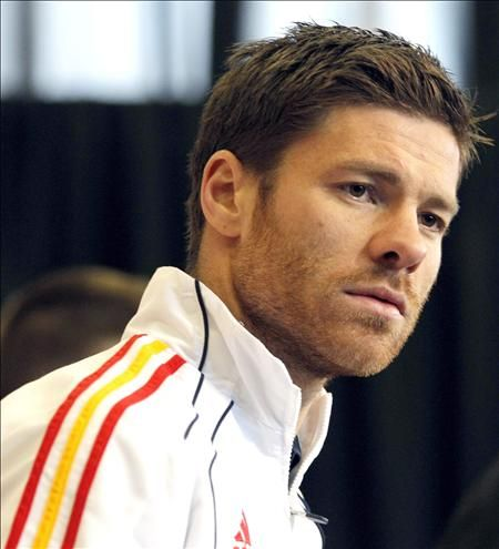 Xavi Alonso  Because I am Watching Soccer ( Football ) just for him! lol